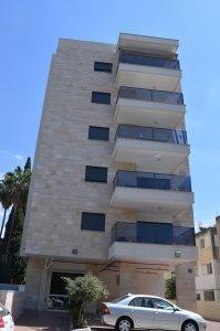 פרויקט הנשיא - ציפוי טרברטין - מבט מהצד אל המרפסות