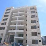 חיפוי בניין בורדור בז' - פרויקט דלקל בוטיק - מבט לחזית